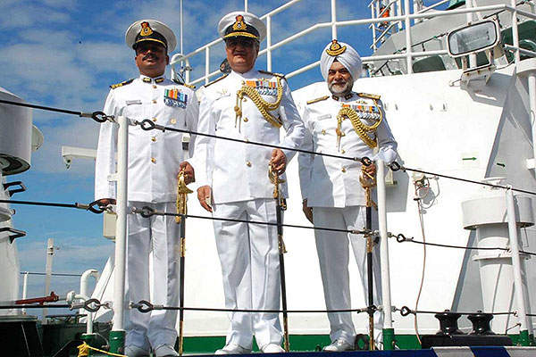 The officials from the Indian Navy and Coast Guard aboard the ICGS Aadesh FPV during its commissioning ceremony.