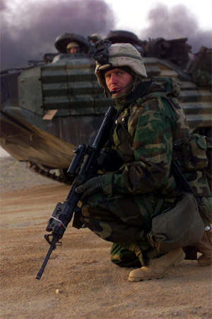 Crouching soldier with large gun