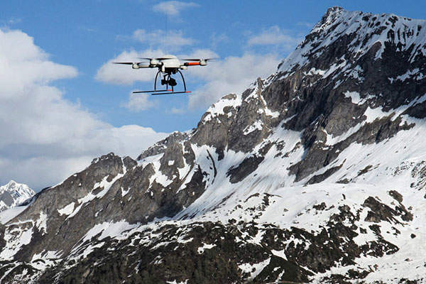 The MD4-1000 UAV was flown for 25 minutes using GPS waypoint navigation across the Alps in June 2013. Image: courtesy of microdrones GMBH.
