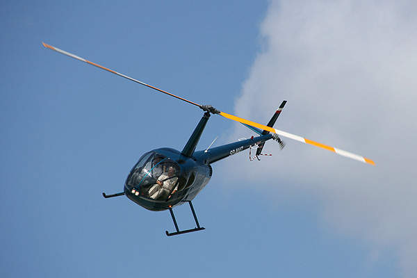 Robinson R44 Raven II integrates law enforcement equipment to conduct policing missions. Image courtesy of Tupungato.