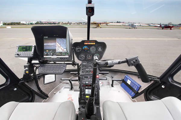 A cockpit view of the R66 Turbine Police Helicopter.