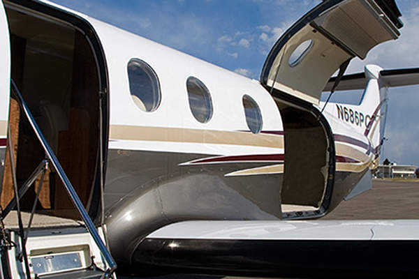 The PC-12 NG aircraft features a forward passenger door and a large cargo door. Image courtesy of Pilatus Aircraft.