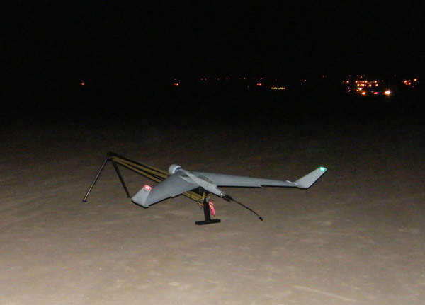 An Orbiter Mini UAV about to take-off from a catapult launcher during a night mission.