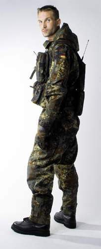 Soldier standing wearing full camoflage uniform